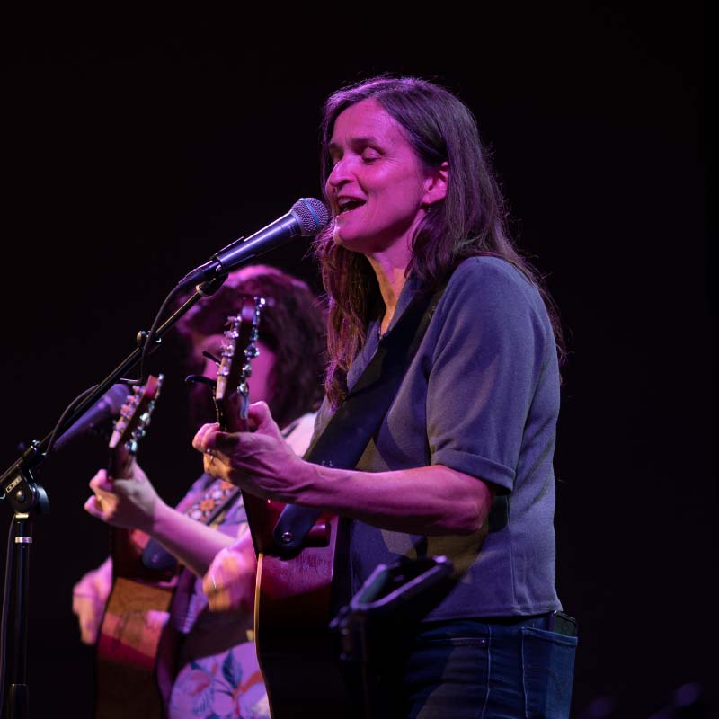 Woman playing a guitar during a worship service