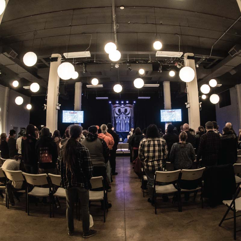 People standing during a worship service at Wilson Abbey